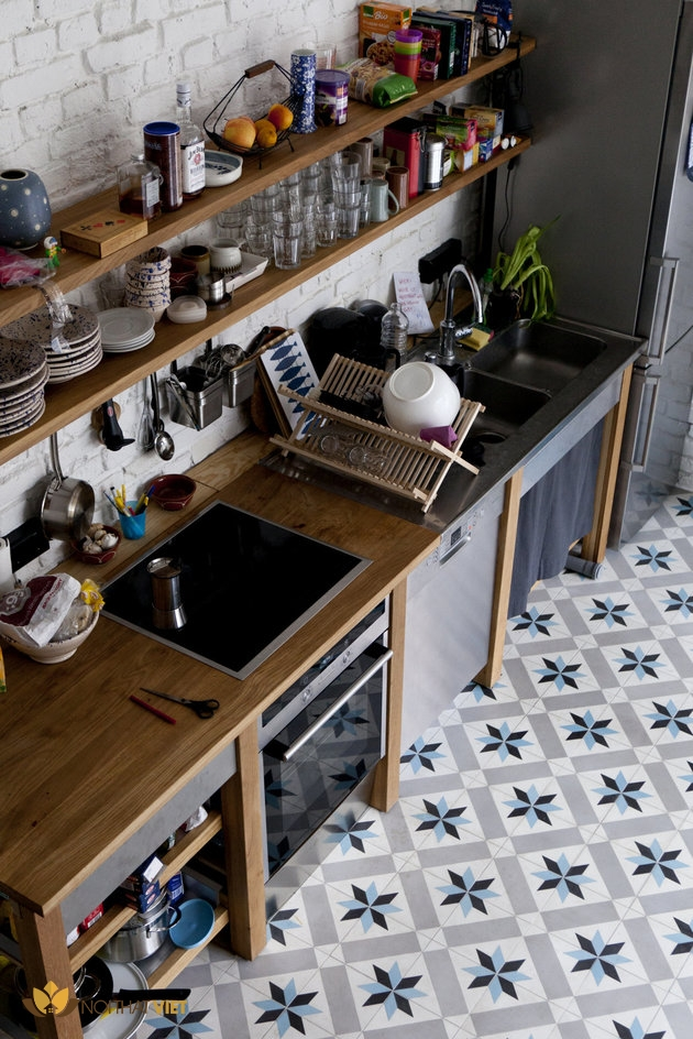A tidy domestic kitchen with flooring that has a star shaped pattern