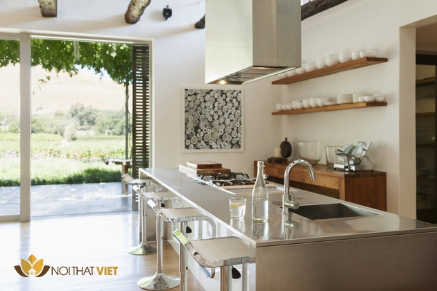 Modern kitchen overlooking patio and vineyard